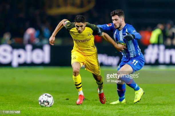 Achraf Hakimi of Borussia Dortmund and Mathew Leckie of Hertha BSC Berlin battle for the ball during the Bundesliga match between Hertha BSC and...
