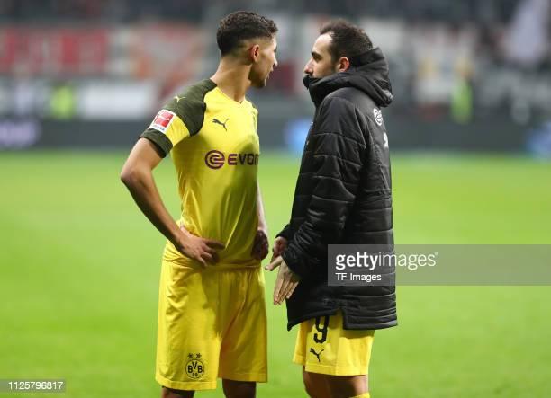 Achraf Hakimi of Borussia Dortmund and Paco Alcacer of Borussia Drotmund and Francisco Alcacer Garcia of Borussia Dortmund talk to each other during...