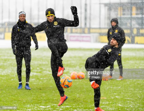Achraf Hakimi of Borussia Dortmund and Paco Alcacer of Borussia Dortmund battle for the ball during a training session at BVB training center on...