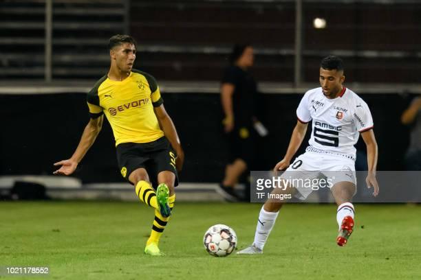 Achraf Hakimi of Borussia Dortmund and Rafik Guitane of Stade Rennais battle for the ball during the friendly match between Borussia Dortmund and...