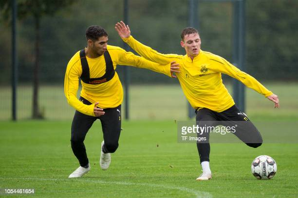 Achraf Hakimi of Borussia Dortmund and Sergio Gomez of Borussia Dortmund battle for the ball during a training session on September 23 2018 in...