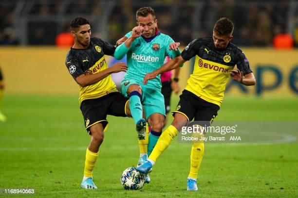 Achraf Hakimi of Borussia Dortmund Arthur of FC Barcelona and Thorgan Hazard of Borussia Dortmund during the UEFA Champions League group F match...