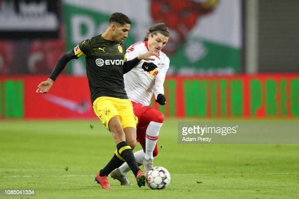 Achraf Hakimi of Borussia Dortmund battles for possession with Marcel Sabitzer of RB Leipzig during the Bundesliga match between RB Leipzig and...