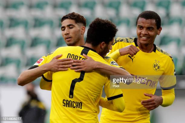 Achraf Hakimi of Borussia Dortmund celebrates after scoring his sides second goal with team-mate Jadon Sancho during the Bundesliga match between VfL...