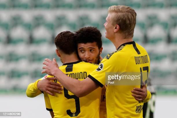 Achraf Hakimi of Borussia Dortmund celebrates after scoring his sides second goal with team-mate Jadon Sancho during the Bundesliga match between VfL...