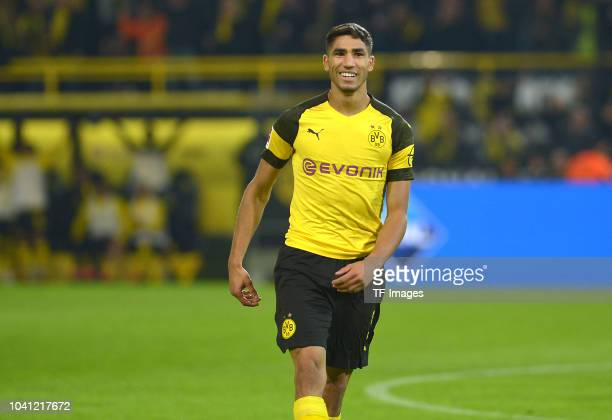 Achraf Hakimi of Borussia Dortmund celebrates after scoring his team`s third goal during the Bundesliga match between Borussia Dortmund and 1 FC...