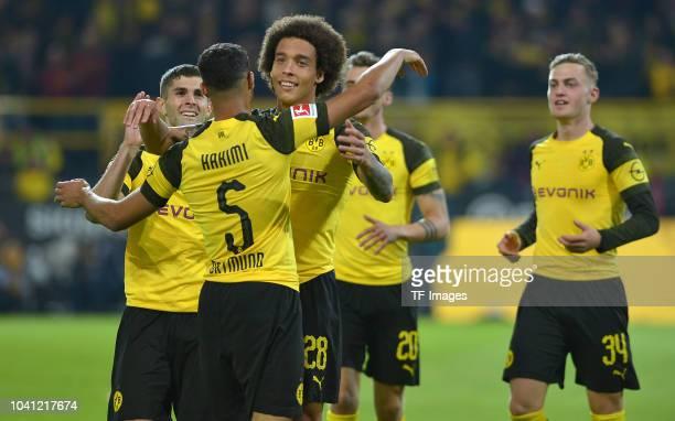 Achraf Hakimi of Borussia Dortmund celebrates after scoring his team`s third goal with team mates during the Bundesliga match between Borussia...