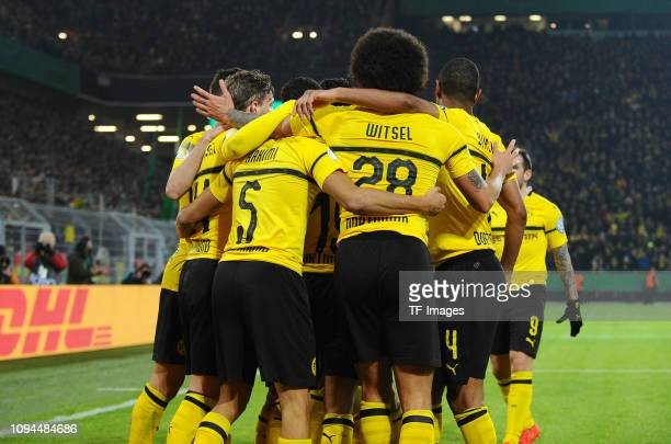 Achraf Hakimi of Borussia Dortmund celebrates after scoring his team's third goal with team mates during the DFB Cup match between Borussia Dortmund...