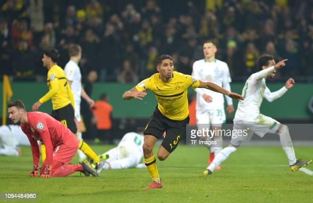 Achraf Hakimi of Borussia Dortmund celebrates after scoring his team's third goal during the DFB Cup match between Borussia Dortmund and Werder...