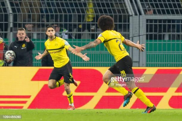 Achraf Hakimi of Borussia Dortmund celebrates after scoring his team's third goal with Axel Witsel of Borussia Dortmund during the DFB Cup match...