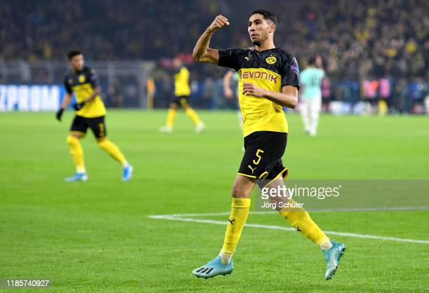 Achraf Hakimi of Borussia Dortmund celebrates after scoring his team's first goal during the UEFA Champions League group F match between Borussia...