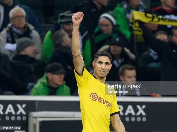 Achraf Hakimi of Borussia Dortmund celebrates after scoring his team's second goal during the Bundesliga match between Borussia Moenchengladbach and...
