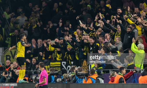 Achraf Hakimi of Borussia Dortmund celebrates with his fans after scoring his team's third goal during the UEFA Champions League group F match...