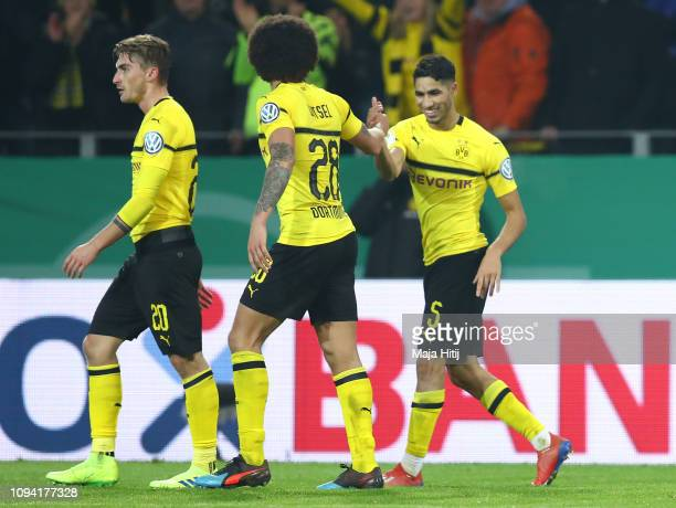 Achraf Hakimi of Borussia Dortmund celebrates with teammates after scoring his team's third goal during the DFB Cup match between Borussia Dortmund...