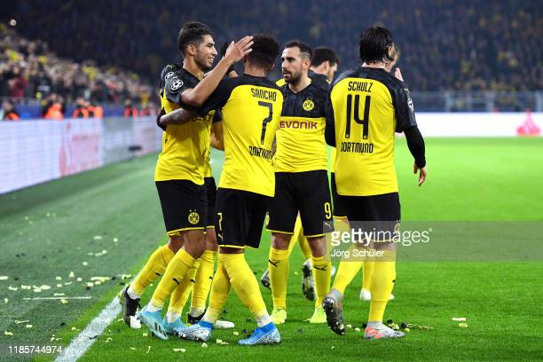 Achraf Hakimi of Borussia Dortmund celebrates with teammates after scoring his team's third goal during the UEFA Champions League group F match...