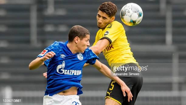 Achraf Hakimi of Borussia Dortmund challenges Amine Harit of FC Schalke 04 during the Bundesliga match between Borussia Dortmund and FC Schalke 04 at...