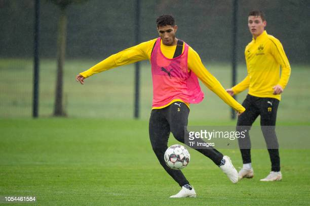 Achraf Hakimi of Borussia Dortmund controls the ball during a training session on September 23 2018 in Dortmund Germany