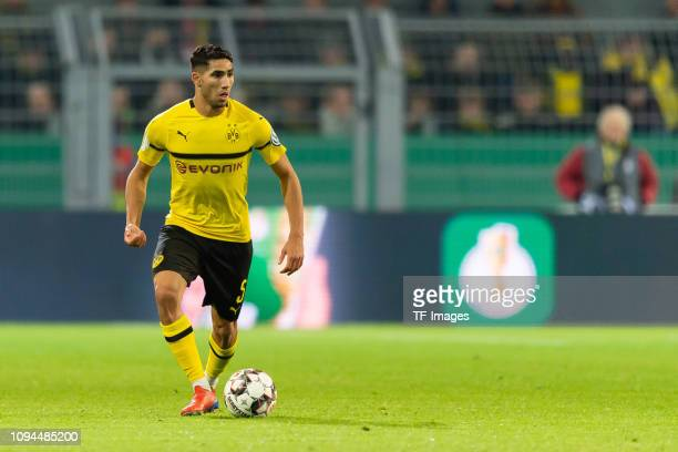Achraf Hakimi of Borussia Dortmund controls the ball during the DFB Cup match between Borussia Dortmund and Werder Bremen at Signal Iduna Park on...