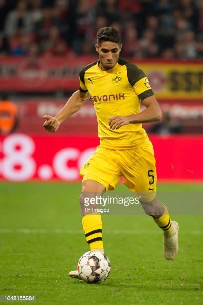 Achraf Hakimi of Borussia Dortmund controls the ball during the Bundesliga match between Bayer 04 Leverkusen and Borussia Dortmund at BayArena on...
