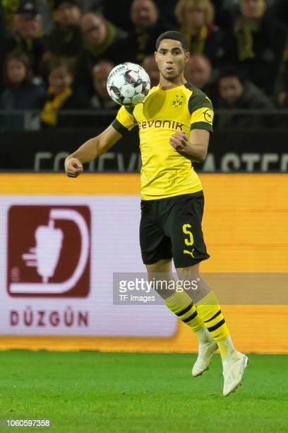 Achraf Hakimi of Borussia Dortmund controls the ball during the Bundesliga match between Borussia Dortmund and FC Bayern Muenchen at Signal Iduna...