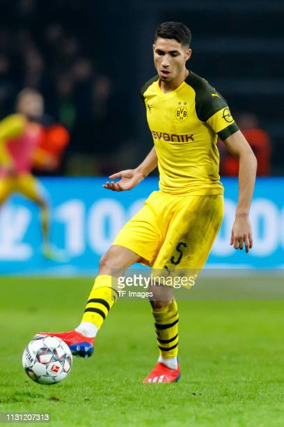 Achraf Hakimi of Borussia Dortmund controls the ball during the Bundesliga match between Hertha BSC and Borussia Dortmund at Olympiastadion on March...