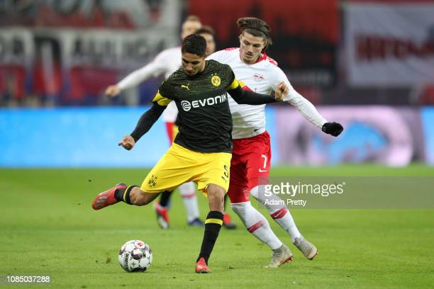 Achraf Hakimi of Borussia Dortmund is challenged by Marcel Sabitzer of RB Leipzig during the Bundesliga match between RB Leipzig and Borussia...