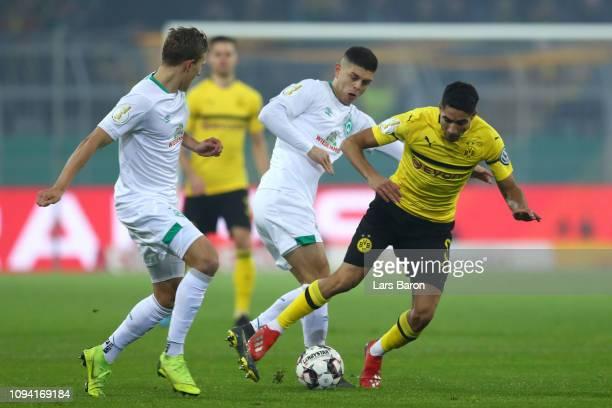 Achraf Hakimi of Borussia Dortmund is challenged by Milot Rashica of Werder Bremen during the DFB Cup match between Borussia Dortmund and Werder...