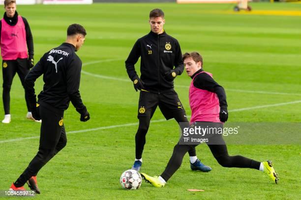 Achraf Hakimi of Borussia Dortmund Julian Weigl of Borussia Dortmund and Sergio Gomez of Borussia Dortmund battle for the ball during a training...