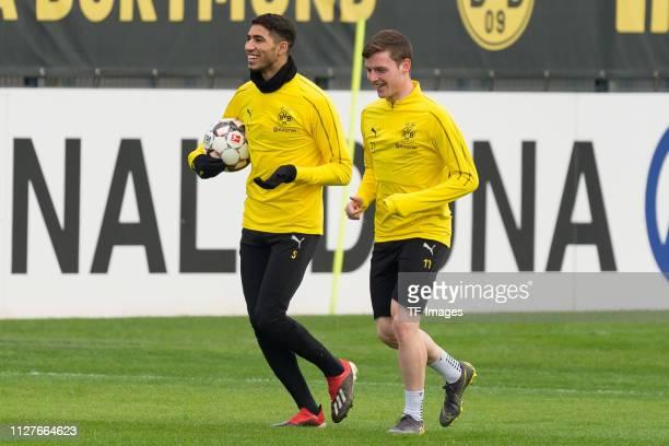 Achraf Hakimi of Borussia Dortmund laughs with Sergio Gomez of Borussia Dortmund during a training session at the Borussia Dortmund training center...