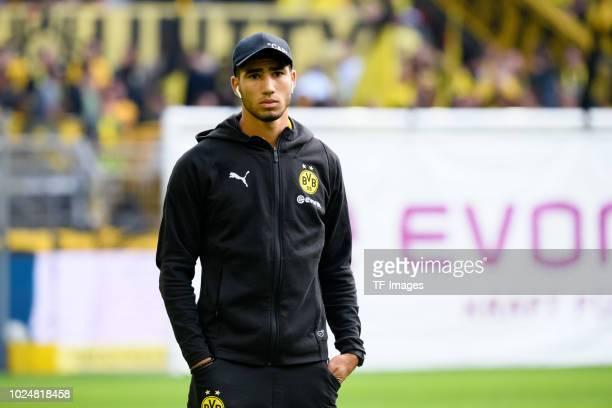 Achraf Hakimi of Borussia Dortmund looks on prior to the Bundesliga match between Borussia Dortmund and RB Leipzig at Signal Iduna Park on August 26...