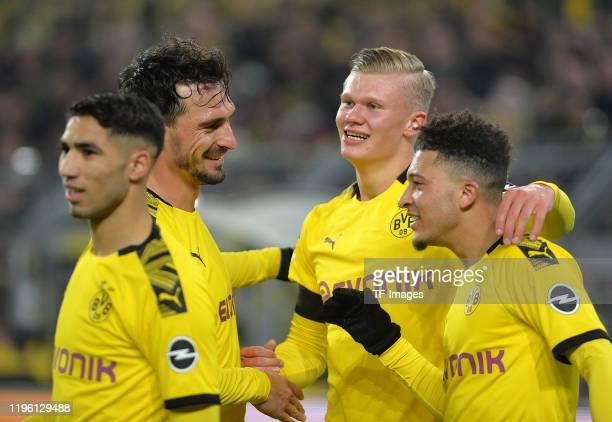 Achraf Hakimi of Borussia Dortmund Mats Hummels of Borussia Dortmund Erling Braut Haaland of Borussia Dortmund and Jadon Sancho of Borussia Dortmund...