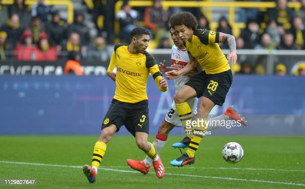 Achraf Hakimi of Borussia Dortmund Nicolas Gonzalez of VfB Stuttgart and Axel Witsel of Borussia Dortmund battle for the ball during the Bundesliga...