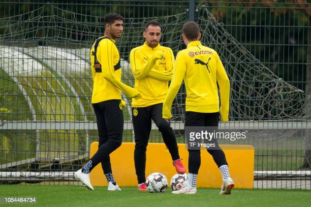 Achraf Hakimi of Borussia Dortmund Paco Alcacer of Borussia Dortmund and Sergio Gomez of Borussia Dortmund look on during a training session on...