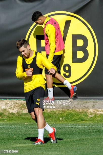 Achraf Hakimi of Borussia Dortmund Raphael Guerreiro of Borussia Dortmund looks on during a training session as part of the Borussia Dortmund...