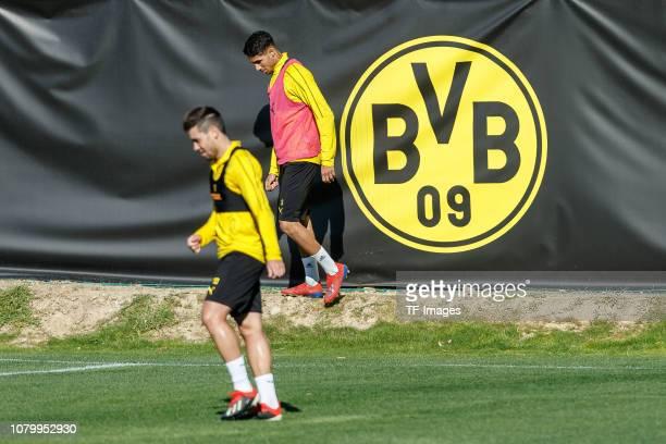 Achraf Hakimi of Borussia Dortmund Raphael Guerreiro of Borussia Dortmund looks on during a training session as part of the Borussia Dortmund...