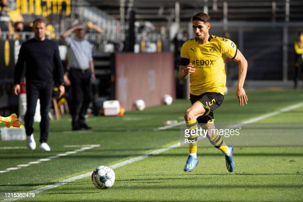 Achraf Hakimi of Borussia Dortmund runs with the ball during the Bundesliga match between Borussia Dortmund and FC Bayern Muenchen at Signal Iduna...