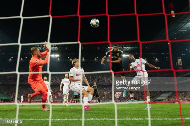 Achraf Hakimi of Borussia Dortmund scores his side's second goal past Tim Horn of 1 FC Koeln during the Bundesliga match between 1 FC Koeln and...