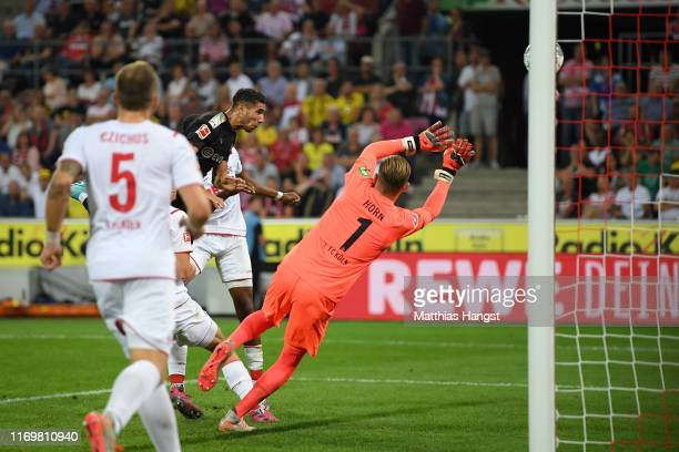 Achraf Hakimi of Borussia Dortmund scores his side's second goal during the Bundesliga match between 1 FC Koeln and Borussia Dortmund at...