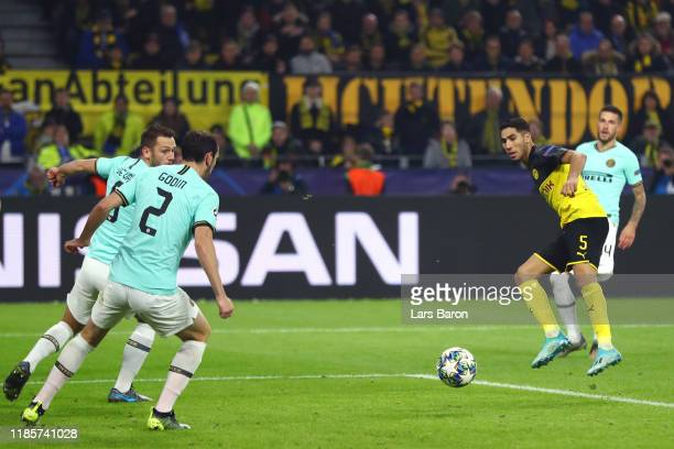 Achraf Hakimi of Borussia Dortmund scores his team's first goal during the UEFA Champions League group F match between Borussia Dortmund and Inter at...