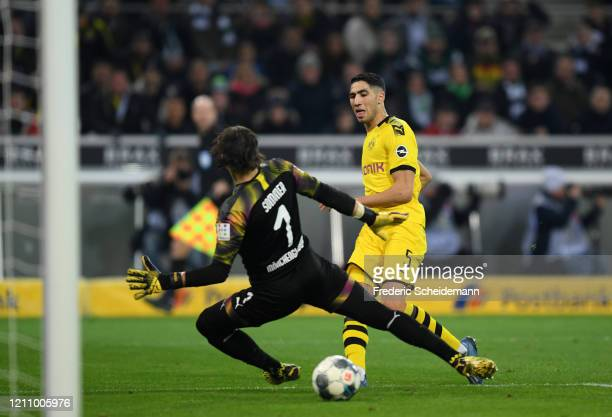 Achraf Hakimi of Borussia Dortmund scores his team's second goal during the Bundesliga match between Borussia Moenchengladbach and Borussia Dortmund...