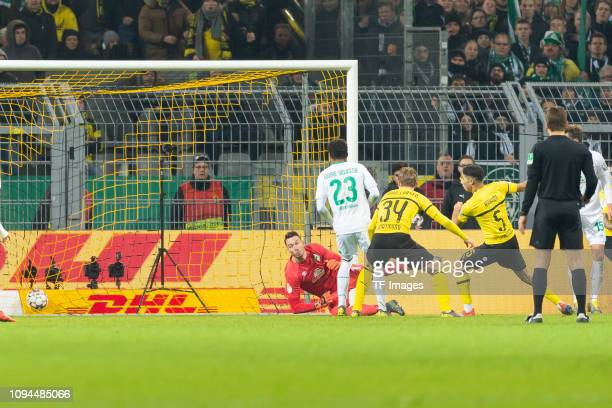 Achraf Hakimi of Borussia Dortmund scores his team's third goal during the DFB Cup match between Borussia Dortmund and Werder Bremen at Signal Iduna...