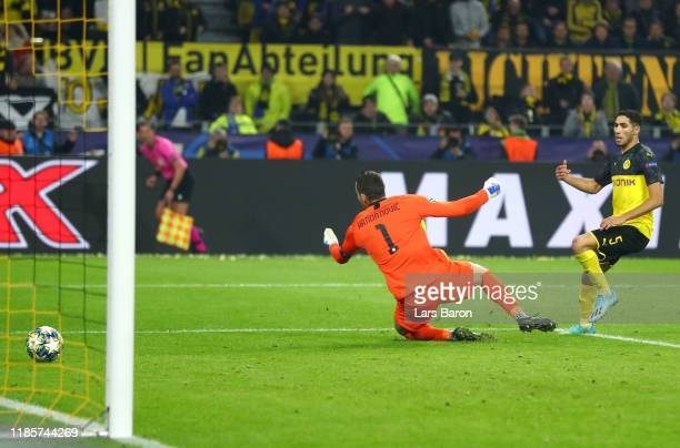 Achraf Hakimi of Borussia Dortmund scores his team's third goal during the UEFA Champions League group F match between Borussia Dortmund and Inter at...