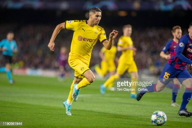 Achraf Hakimi of Borussia Dortmund sets up an early chance during the Barcelona V Borussia Dortmund UEFA Champions League group stage match at...