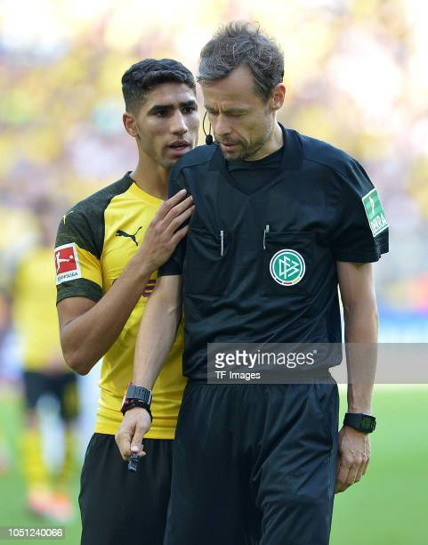 Achraf Hakimi of Borussia Dortmund speaks with referee Markus Schmidt during the Bundesliga match between Borussia Dortmund and FC Augsburg at Signal...
