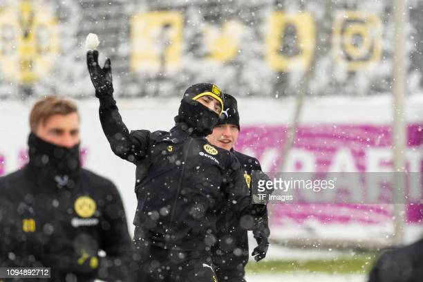 Achraf Hakimi of Borussia Dortmund throws a snowball during a training session at BVB training center on January 31 2019 in Dortmund Germany