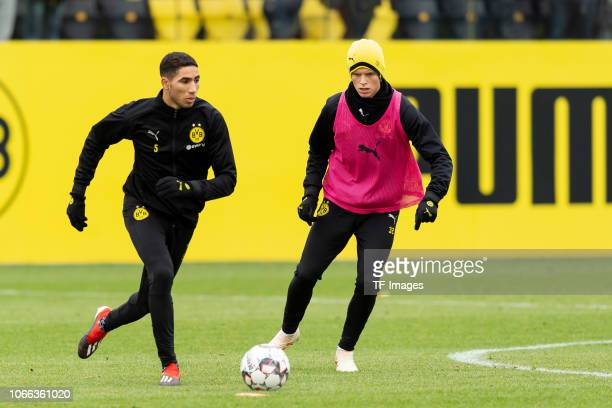 Achraf Hakimi of Dortmund and Dzenis Burnic of Dortmund battle for the ball during a training session at BVB training center on November 29 2018 in...