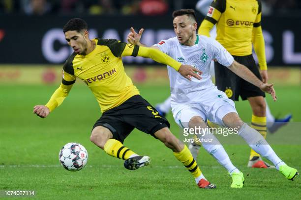 Achraf Hakimi of Dortmund battles for the ball with Kevin Moehwald of Bremen during the Bundesliga match between Borussia Dortmund and SV Werder...