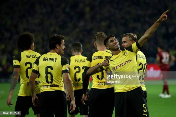 Achraf Hakimi of Dortmund celebrates after he scores the 3rd goal during the Bundesliga match between Borussia Dortmund and 1 FC Nuernberg at Signal...