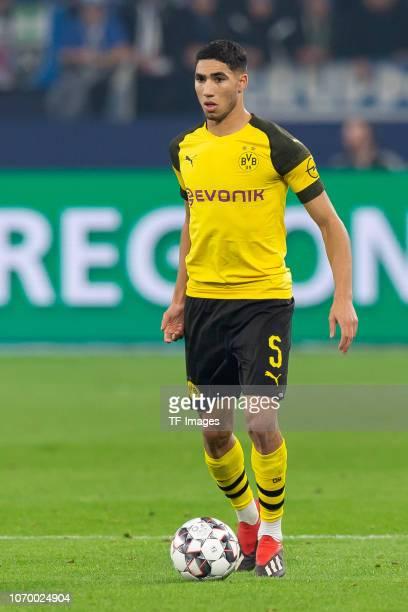 Achraf Hakimi of Dortmund controls the ball during the Bundesliga match between FC Schalke 04 and Borussia Dortmund at the Veltins Arena on December...