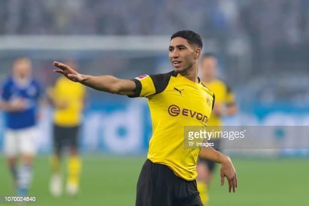 Achraf Hakimi of Dortmund gestures during the Bundesliga match between FC Schalke 04 and Borussia Dortmund at the Veltins Arena on December 08 2018...